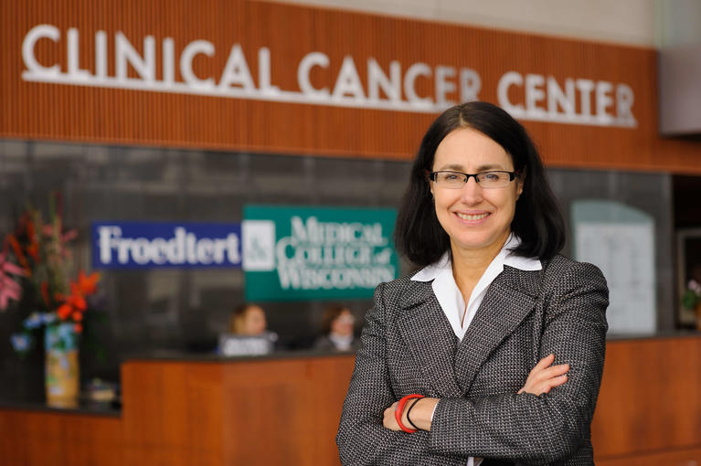 Dr. standing outside of Clinical Cancer Center