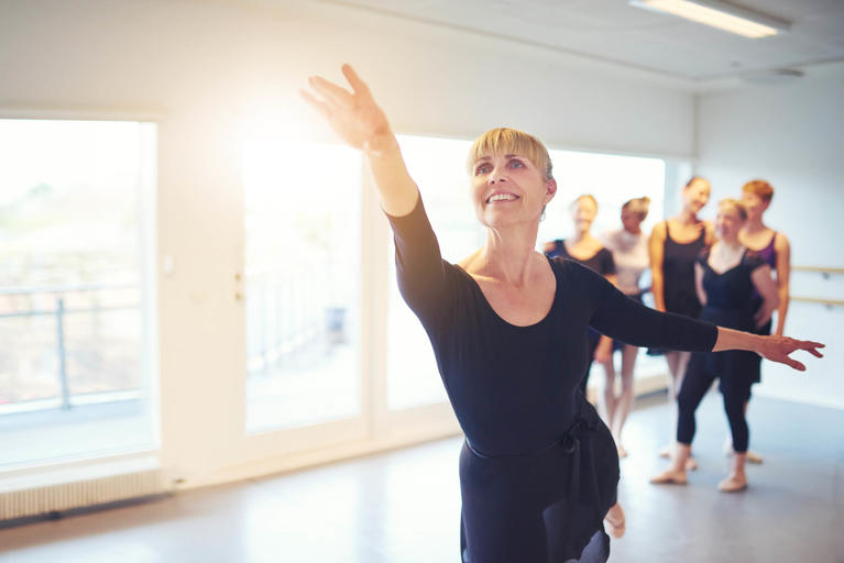 woman-reaching-ballet-class