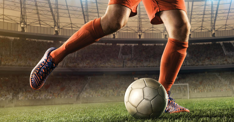 soccer-player-kicking-ball-in-arena