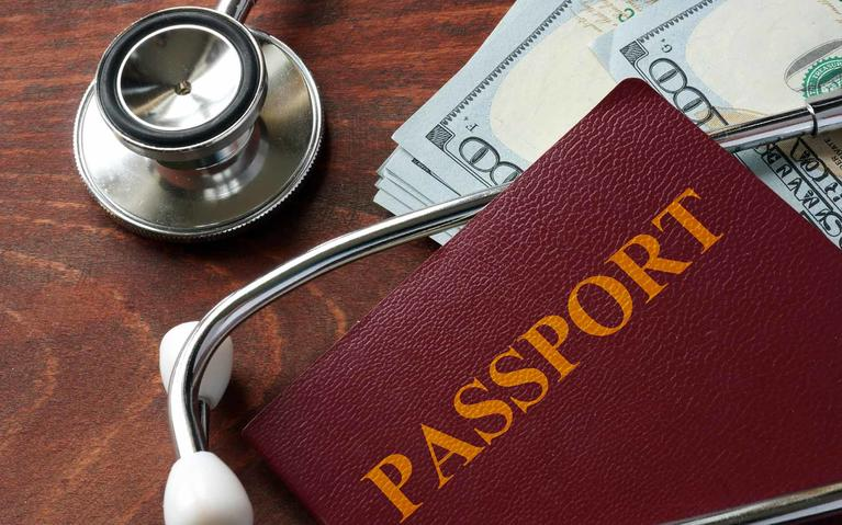 Stethoscope and passport for travel medicine