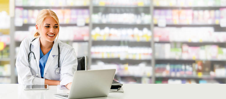 Pharmacist at Counter with Computer