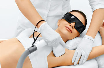 Patient getting laser hair removal on her underarms.