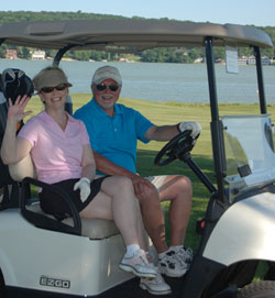 Golf Classic Participants in Cart
